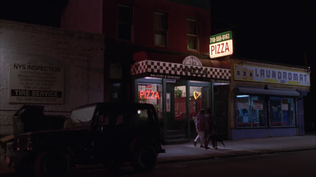 "WIDE ANGLE OF PIZZERIA SIGN, PIZZA RESTAURANT ON CITY STREET NEXT TO LAUNDROMAT. LIGHTS TURN OFF FOR CLOSING. LONG ISLAND CITY, QUEENS. NEON SIGNS.<P><A HREF=""HTTPS://WWW.SONYPICTURESSTOCKFOOTAGE.COM/FOOTAGE?KID=4289"">FOR DAY-NIGHT MATCHING SHOTS, CLICK H"