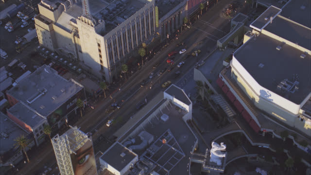 aerial of city street intersection of hollywood blvd and vine. rooftops of hollywood landmarks: kodak theatre, el capitan theatre and grauman's chinese theatre. crashed or overturned semi truck or emergency stops traffic in street outside of multi-story, - el capitan theatre stock videos & royalty-free footage