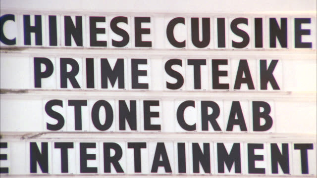 """medium angle of hotel or motel sign or advertisement on marquee board reads """"chinese cuisine/ prime steak/ stone crab/ entertainment"""". - 1997 stock videos & royalty-free footage"""