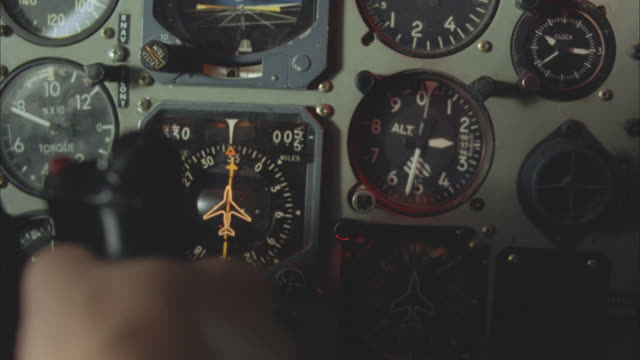 close angle of control or instrument panel of helicopter or airplane. speedometer or airspeed indicator, altitude monitor or altimeter, pressure gauges, magnetic compass, heading indicator, vertical speed indicator. joystick or controller and hand visible - interior stock videos & royalty-free footage