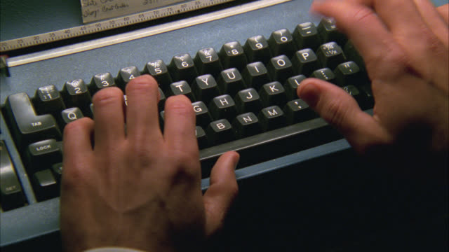 close angle of man's hands, fingers typing on typewriter keyboard. - typewriter keyboard stock videos & royalty-free footage