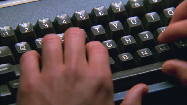 close angle of man's hands, fingers typing on typewriter keyboard. - 1978 stock videos & royalty-free footage