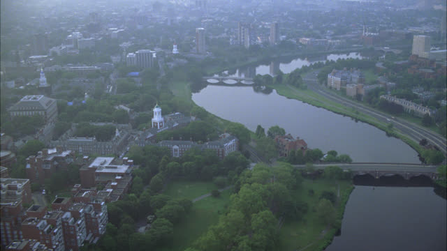 aerial of charles river in cambridge, massachusetts near harvard university campus. apartment building, dormitories, campus buildings, and university visible. college campuses. ivy league. boston. - charles river stock videos & royalty-free footage