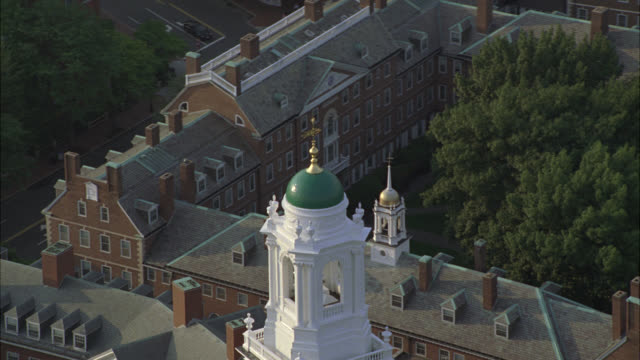 stockvideo's en b-roll-footage met aerial of administration buildings on harvard campus. college or university. ivy league. building has tower and spire. trees surround campus. boston. - harvard university