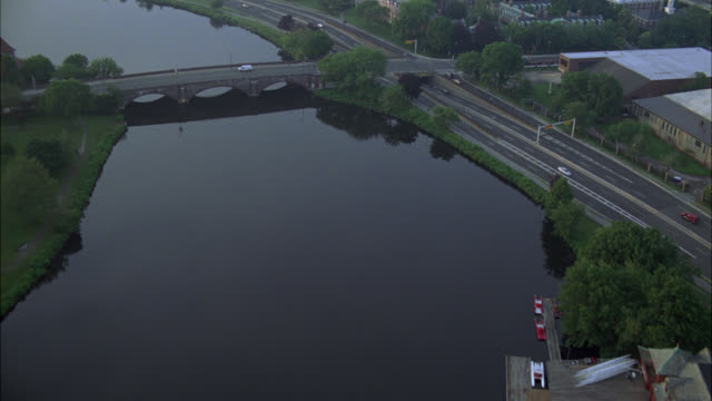 aerial of charles river in cambridge, massachusetts near harvard university campus. apartment buildings, dormitories, campus buildings, and university visible. college campuses. ivy league. boston. - cambridge massachusetts stock videos & royalty-free footage