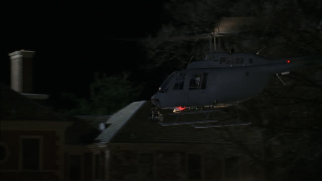 pan down of helicopter landing in front of large estate or mansion. police and emergency vehicles parked in front. flashing lights and bizbars.  could be crime scene or emergency. marshall field house at caumsett state historic park on long island sound. - military helicopter stock videos & royalty-free footage