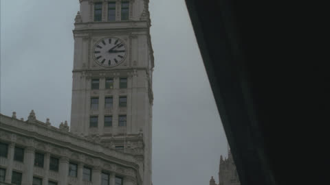 up angle of clock tower on wrigley building. skyscraper or high rise. landmark. - wrigley building video stock e b–roll