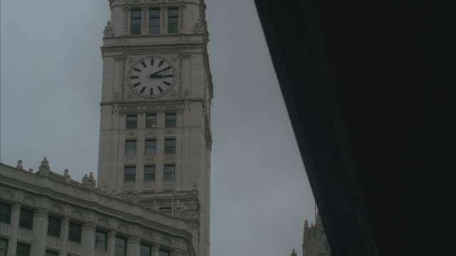 UP ANGLE OF CLOCK TOWER ON WRIGLEY BUILDING. SKYSCRAPER OR HIGH RISE. LANDMARK.