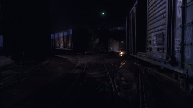medium angle of boxcar trains on railroad tracks. could be railyard. - c119gs点の映像素材/bロール