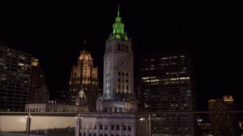wide angle of wrigley building or clock tower. skyscrapers. high rise office or apartment buildings. city skyline. pov from rooftop. - wrigley building video stock e b–roll