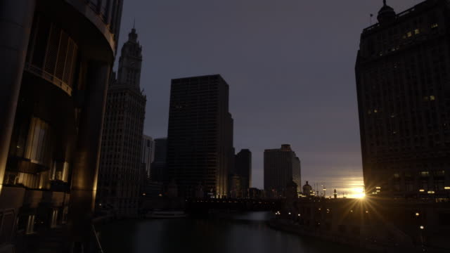 WIDE ANGLE OF CHICAGO RIVER AND MICHIGAN AVENUE BRIDGE. WRIGLEY BUILDING, CLOCK TOWER AND OTHER SKYSCRAPERS, HIGH RISE OFFICE OR APARTMENT BUILDINGS IN BG.