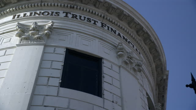 up angle of window on illinois trust financial office building. could be bank. - fensterfront stock-videos und b-roll-filmmaterial