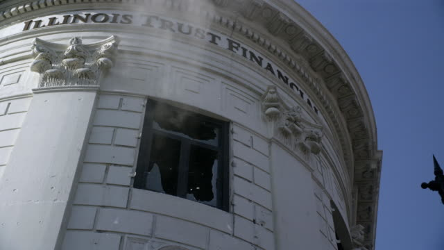 up angle of window on illinois trust financial office building. could be bank. window breaks, could be from explosion. broken glass. - fensterfront stock-videos und b-roll-filmmaterial