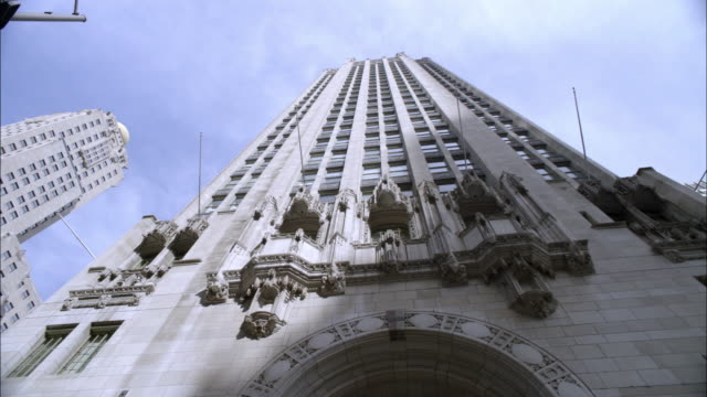 up angle of tribune tower, stone or concerte office building or skyscraper. neo-gothic architecture. - tribune tower stock-videos und b-roll-filmmaterial