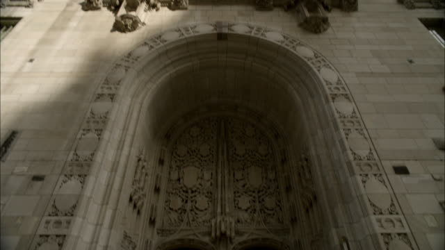 pan down of tribune tower, stone or concerte office building or skyscraper. neo-gothic architecture. - tribune tower stock-videos und b-roll-filmmaterial