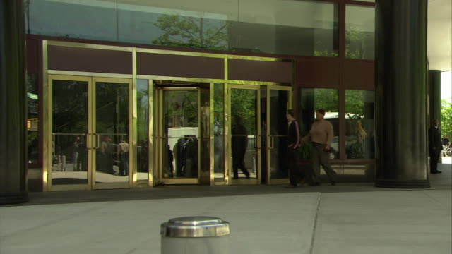 wide angle of glass doors, entrance to office building. revolving doors. - building entrance stock videos & royalty-free footage