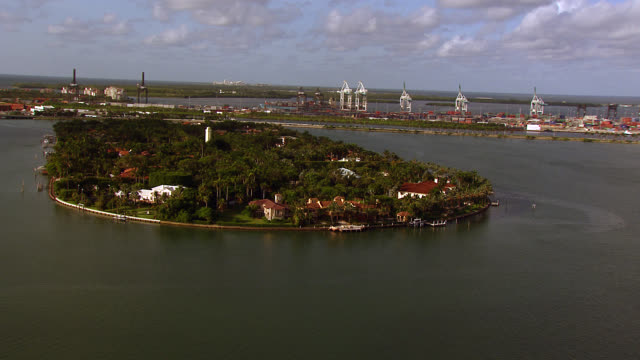 aerial of star island in bay, miami. bridges. skyscrapers and high rise apartment buildings, condominiums or hotels in bg. tropical. miami city skyline. - star island stock videos & royalty-free footage