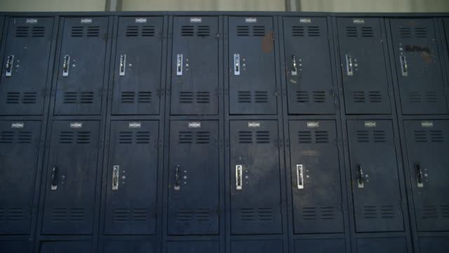 medium angle of lockers. could be outdoor walkway in middle school or high school. actual location is nordhoff high school. - junior high stock videos & royalty-free footage