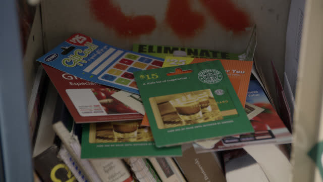 close angle of hand opening locker and picking up gift cards. books. - hand of cards stock videos & royalty-free footage