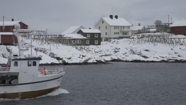 lofoten islands. boat passes through - aptenia stock-videos und b-roll-filmmaterial