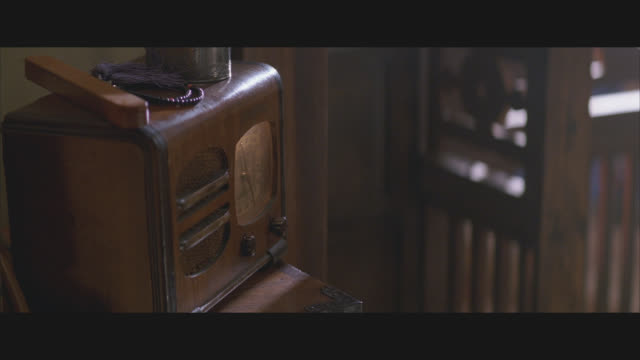 close angle of radio, cup, bracelets on small wooden dresser. woman's hand reaches to control knob. - 1920 1929 stock videos & royalty-free footage