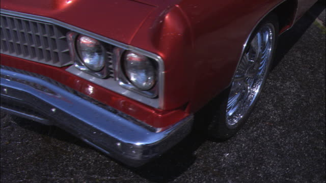 pan right to left on front left bumper of red classic cadillac. just washed. could be vintage low rider or convertible. - cadillac stock videos & royalty-free footage