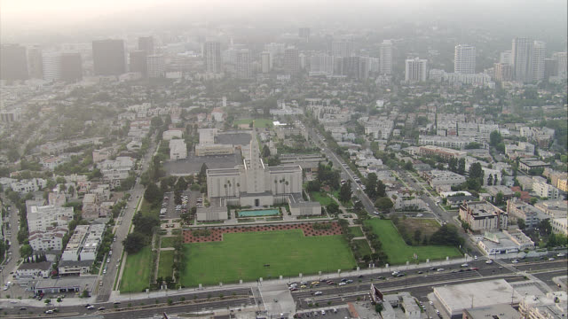 aerial of city skyline, downtown, or multi-story office buildings. los angeles temple, santa monica blvd, city streets, and houses in upper class neighborhood or residential area visible. - santa monica blvd stock videos & royalty-free footage