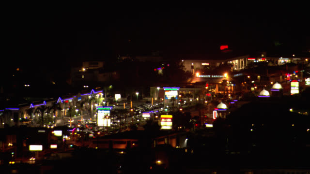 aerial over sunset boulevard near hollywood. city skylines. - sunset boulevard stock-videos und b-roll-filmmaterial