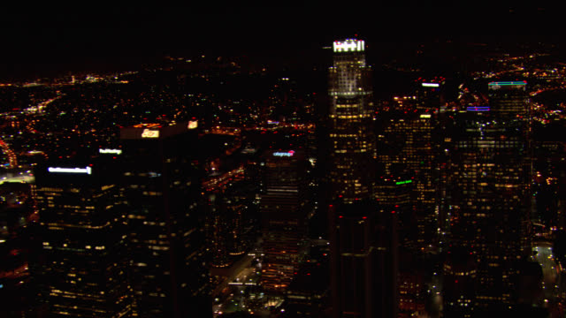 aerial of downtown los angeles skyline. skyscrapers and high rise office buildings. city lights in background. zoom in, out on us bank tower. - us bank tower stock videos & royalty-free footage