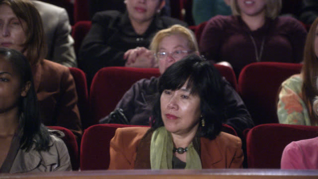 pan left to right of people, women in audience cheering or chanting and then reacting in shock or surprise. could be daytime talk show. could be theater or auditorium. - talk show stock videos & royalty-free footage