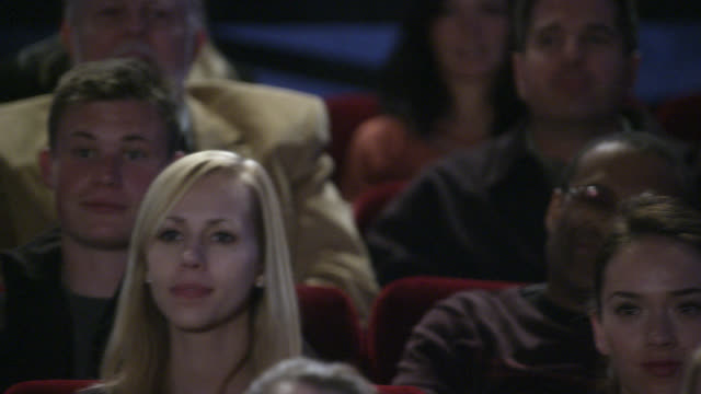 pan left to right of people in audience cheering or chanting and then reacting in shock or surprise. could be daytime talk show. could be theater or auditorium. - talk show stock videos & royalty-free footage