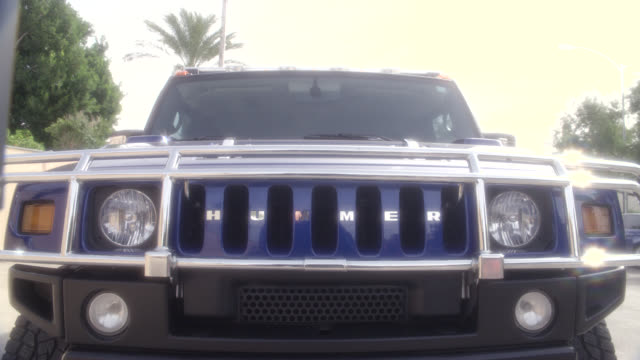 pan up to radiator grille and logo of hummer suv or car. luxury cars, upper class. - hummer stock videos and b-roll footage