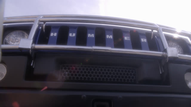 up angle of radiator grille and logo of hummer suv or car. luxury cars, upper class. - hummer stock videos and b-roll footage