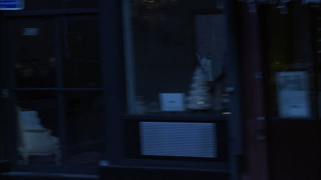 stockvideo's en b-roll-footage met hand held driving pov from right side of car on new york city street in commercial area. pass horse drawn carriage on tree lined street and high rise and skyscraper office buildings in bg, shops, cars parked on street, trees with bare branches, pedestrian - bare tree