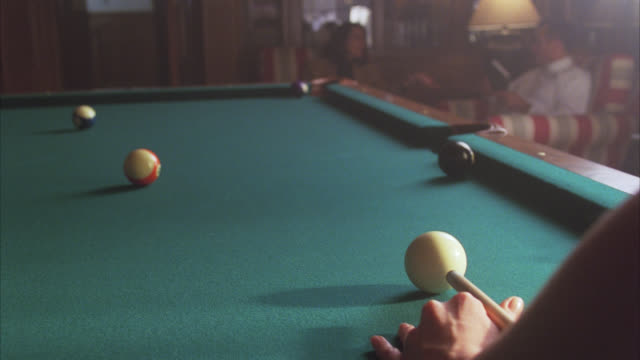 close angle of pool cue hitting ball into pocket. pool table, billiards. games. - cue ball stock videos & royalty-free footage