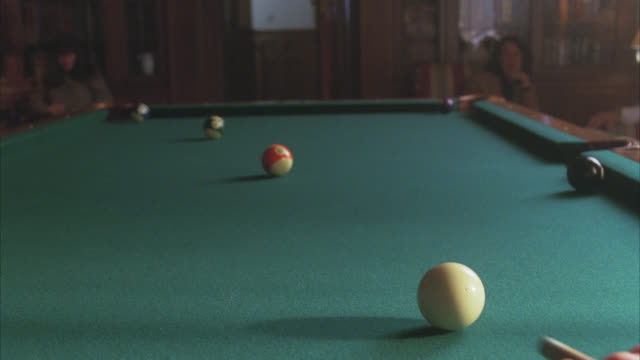 close angle of pool cue hitting ball. pool table, billiards. games. - cue ball stock videos & royalty-free footage