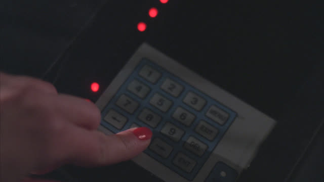 close angle of woman's hands pressing buttons on keypad. could be security code. could be for spy. electronic devices. - security code stock videos and b-roll footage