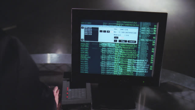 close angle of computer screen or monitor. codes, could be for spy. burn-in. - 2000 stock-videos und b-roll-filmmaterial