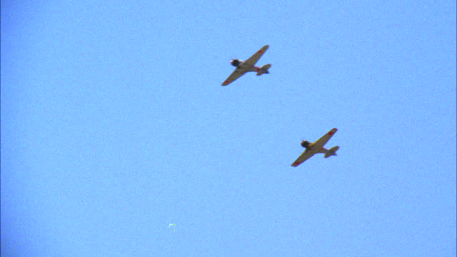 up angle of two japanese zeros airplanes, fighter aircraft flying in sky. airplanes bombers. world war ii wwii. sky. single engine planes. wwii bombers. - pearl harbor stock videos and b-roll footage