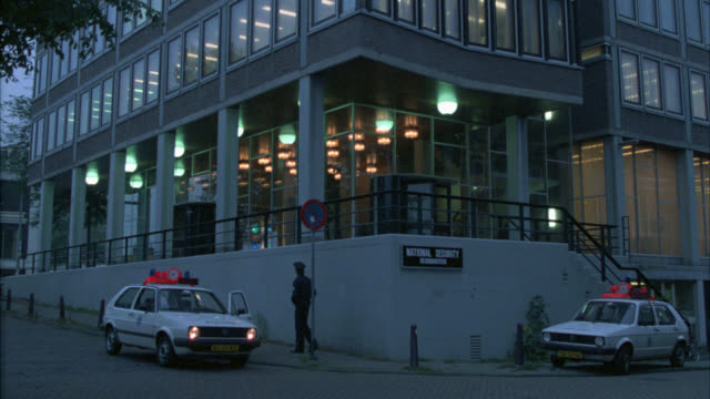wide angle of national security headquarters. netherlands, holland police department. could be international police or cia or federal crime bureau investigation. official government office building. - hauptfirmensitz stock-videos und b-roll-filmmaterial
