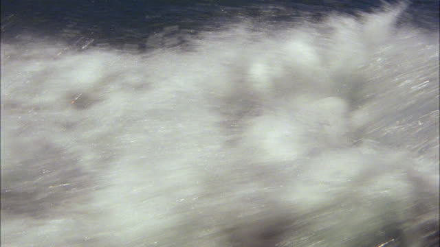close angle of boat or ship's wake. could be ocean or lake. - wake water stock videos & royalty-free footage