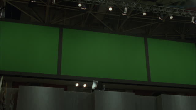 up angle of three large television screens, monitors or jumbotrons. green screen. burn-in. could be in stadium or arena. - large scale screen stock videos & royalty-free footage