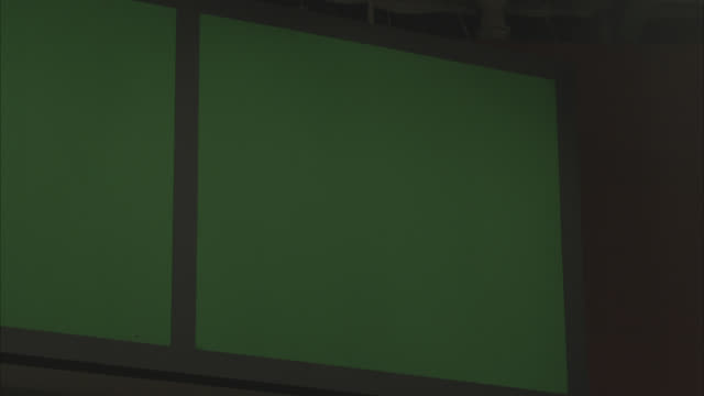 up angle of large television screens, monitors or jumbotrons. green screen. burn-in. could be in stadium or arena. - large scale screen stock videos & royalty-free footage