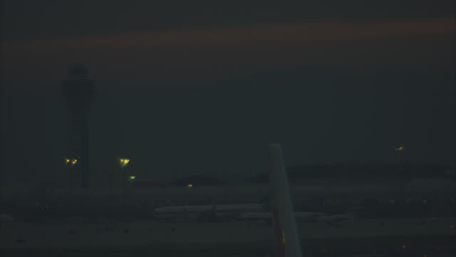 wide angle of beijing airport. control tower in bg. smog. - air traffic control tower stock videos and b-roll footage
