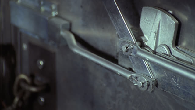 close angle of metal or steel door on inside of truck or armored truck. handle moves back and forth. chain on door. - door chain stock videos & royalty-free footage