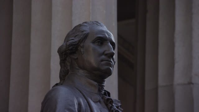zoom in and out of george washington statue in front of the federal building at wall street. financial district. federal hall national memorial building. - federal building stock videos & royalty-free footage