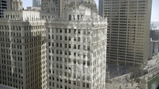 WIDE ANGLE OF WRIGLEY BUILDING IN DOWNTOWN CHICAGO. COULD BE OFFICE BUILDING, APARTMENT BUILDING, OR HOTEL. LANDMARKS.