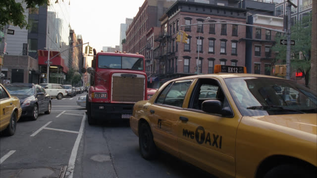 PROCESS PLATE BACK RIGHT DRIVING ON NEW YORK CITY STREETS. MULTI-STORY AND HIGH RISE OFFICE OR APARTMENT BUILDINGS. PARKING LOTS.