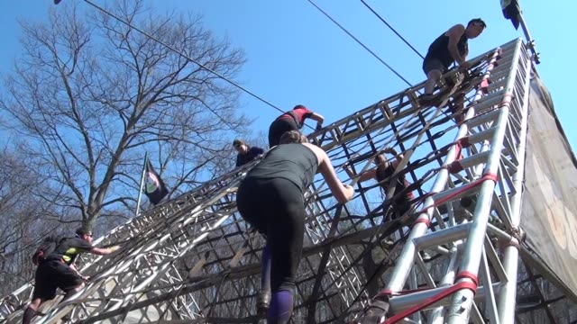 obstacle racer heads up 20' wall - salmini stock videos and b-roll footage