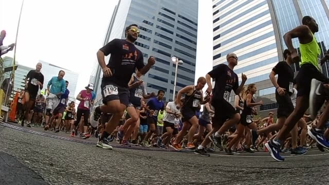 thousands participate in running race slow motion start - salmini stock videos and b-roll footage